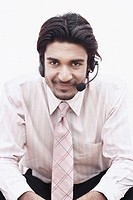 Portrait of a businessman wearing a hands free device