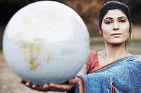 Portrait of a young woman holding a globe (thumbnail)