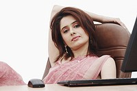 Portrait of a businesswoman sitting in front of a computer