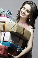 Portrait of a young woman holding gifts