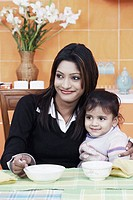 Close-up of a mother with her daughter at the dining table (thumbnail)