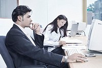Businessman and a businesswoman sitting in an office