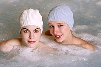 Two women in jacuzzi at a spa