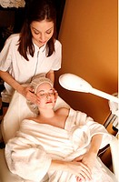 Woman having a facial treatment at a spa