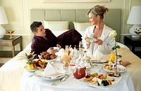 Mature couple having room service breakfast (thumbnail)