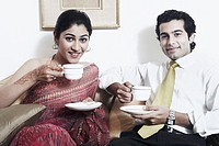 Portrait of a young couple drinking tea