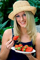 Woman holding a plate of strawberries