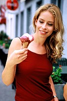 Woman looking at her melting ice-cream (thumbnail)