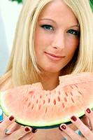 Woman eating water-melon