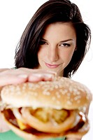Woman showing a burger