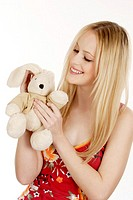 Woman playing with her bunny soft toy (thumbnail)