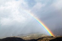 Rainbow over Sierra Nevada. Granada province, Andalusia, Spain