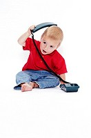 Boy playing with telephone (thumbnail)
