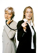 Businesswoman talking on a disconnected woman