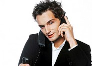 Businessman busy answering phone calls (thumbnail)