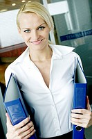 Businesswoman holding files