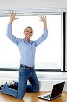 Businesswoman extending high five after completing her project