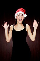 Woman with christmas hat laughing happily