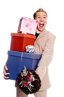 Portrait of man carrying gifts