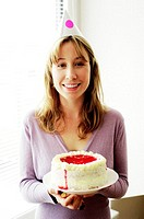 Woman holding a cake.
