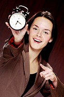Businesswoman holding an alarm clock.