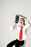 Woman lifting up her laptop (thumbnail)