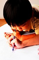Boy watching his parent drawing.