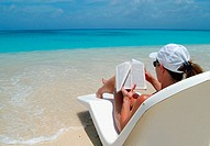 Woman reading book on tropical beach. Bikini Atoll. Marshall Islands