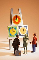 Business people figures and clocks