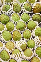 Custard apples at La Boquería market, Barcelona. Catalonia, Spain