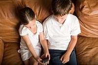 Brother and sister listening to MP3 player