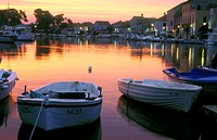 Sunrise over Stari Grad harbor with fishing boats. Hvar Island, Dalmatia. Croatia