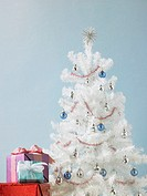 Christmas tree with gifts piled high (thumbnail)