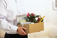 Businessman carrying box (thumbnail)