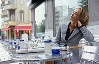 Blonde Businesswoman sitting at a Bistro Table - Cafe - Leisure Time