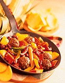Pan-cooked meatball dish with peppers, baby corn & chili