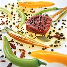 Raw beef steak in pepper marinade with capers & chillies