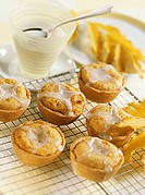 Macadamia cream tarts with glacé icing