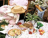 Picnic with sausage, cheese and cakes
