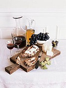 Still life with goat´s cheese, raisin bread, grapes & red wine