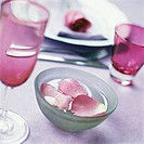 Bowl of water with rose petal (table decoration)