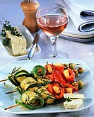 Cheese and vegetable kebabs with herb butter