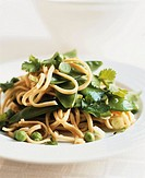 Linguine with mangetout, peas and coriander leaves