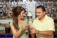 Mature couple toasting with wine glasses