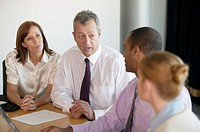 Business people in meeting, close-up