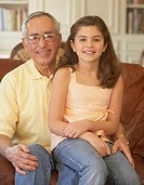 Portrait of a girl sitting on her grandfather´s lap