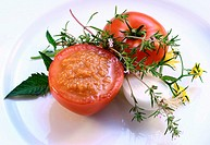 Tomato sauce in hollowed-out tomato, fresh herbs