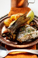 Sea bass with roast potatoes Morocco