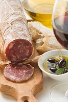 Italian salami, olives in olive oil, white bread