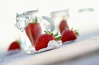 Fresh strawberries and preserving jars